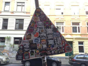 Stickered street sign / Various artists
